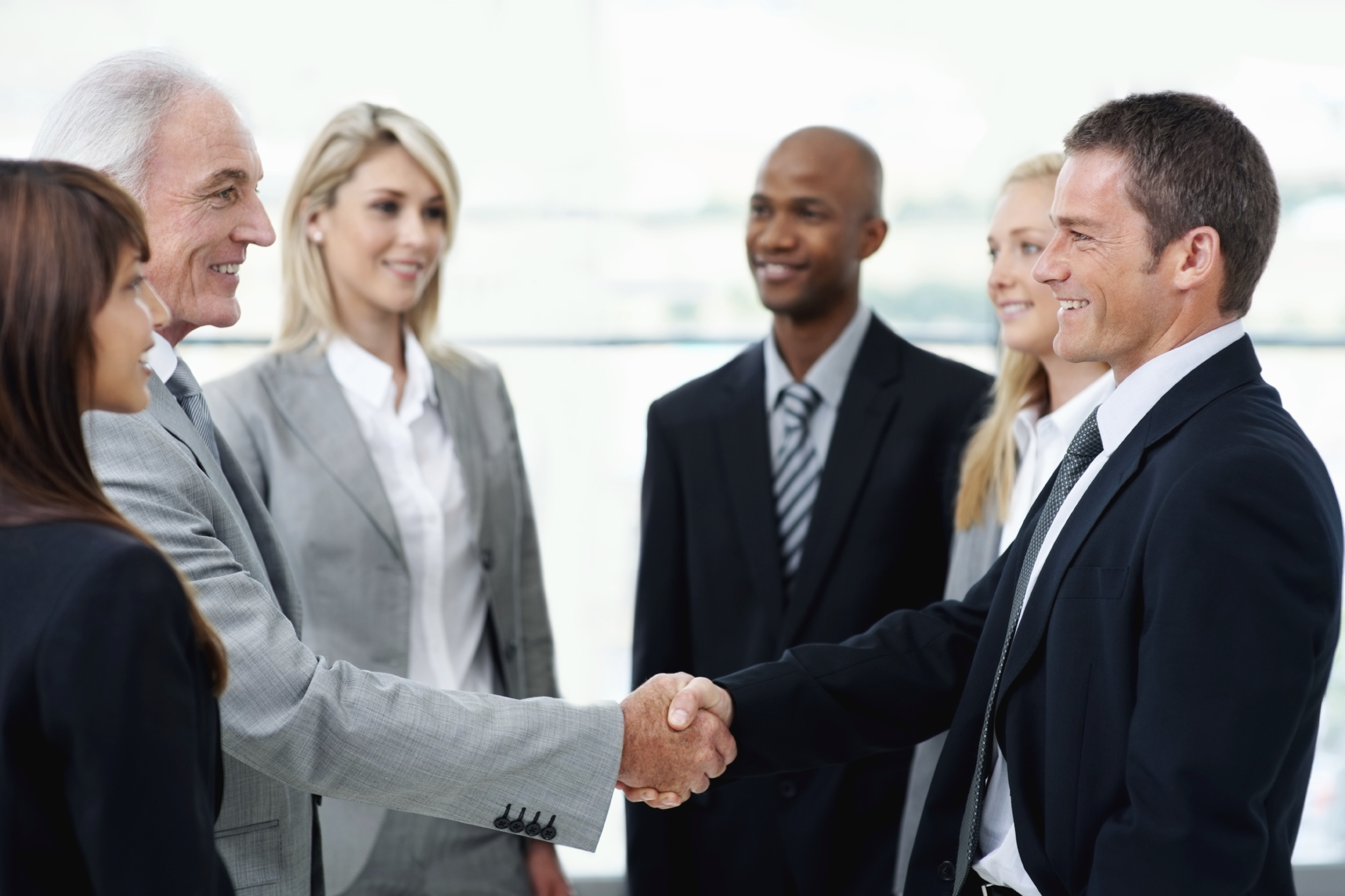 Senior business man handshaking with partner after striking a deal